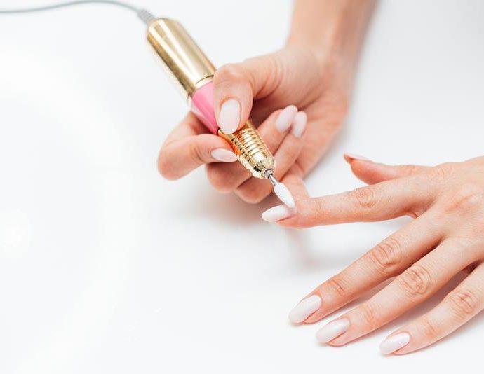 woman-using-digital-nail-file-high-view